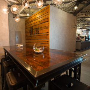 Enjoy excellent coffee at a table at 40 LBS Coffee bar in the Historic Yamhill District